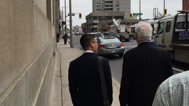 Officer Kudo Park, left, leaves the Hamilton courthouse with his defence attorney, Gary Clewley in April, when he was found guilty of assault.