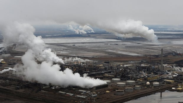 Emissions rise above the Syncrude oil sands extraction facility, with the Suncor extraction facility in the background, near Fort McMurray. As part of the 2015 Paris Agreement, Canada agreed to a target of 523 million tonnes by 2030 -- 30 per cent less than what the country generated in 2005.