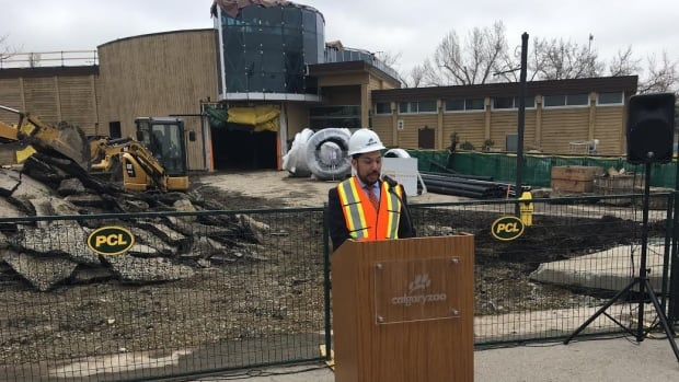 Alberta's Minister of Culture and Tourism, Ricardo Miranda, talks about the new Panda Passage exhibit, which is under construction at the Calgary Zoo behind him.