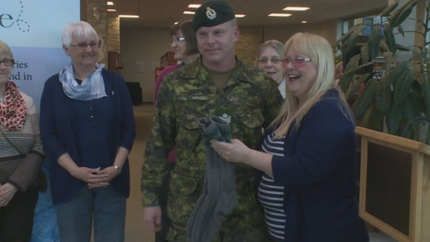 Steve Smith and others from the Royal Newfoundland Regiment were given socks during a ceremony in Corner Brook on Wednesday.