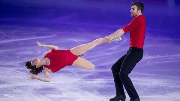 Canadian pairs skater Eric Radford, right, was diagnosed with a herniated disc at his L2 vertebra in his lower back, compressing the nerve to his hip. He said that although it's more serious than expected, knowing what was wrong was a relief.