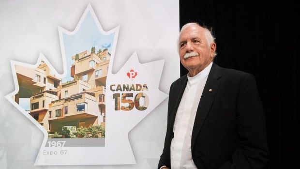 Architect Moshe Safdie looks at a new Canada Post stamp depicting his famous Habitat 67 housing complex to celebrate Expo 67 during its unveiling in Montreal, Thursday, April 27, 2017.