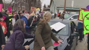 Saskatchewan budget protesters swarm cars outside Premier's Dinner venue in Saskatoon