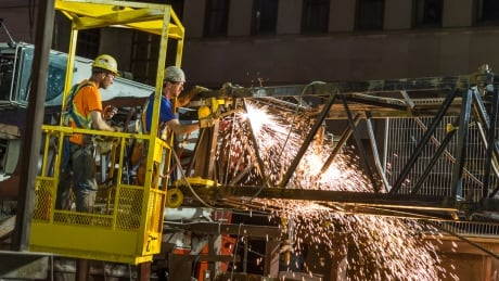 Mobile crane falls over workers cut off boom Leonard Poole April 26 2017