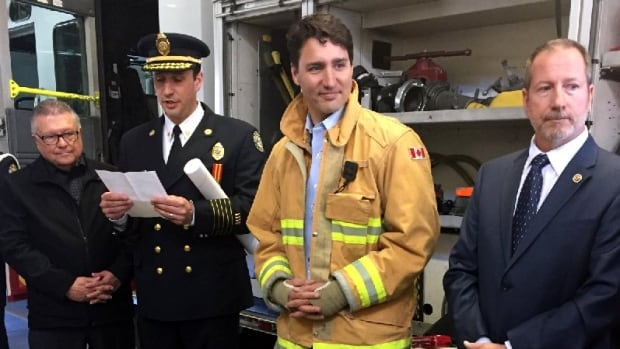 Prime Minister Justin Trudeau posed in a firefighter's jacket during a recent visit to Fire Hall Number 4 in Regina.