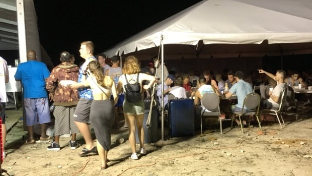 Attendees at Fyre Festival in the Bahamas were promised a luxurious, private party, but instead found themselves eating bread and cheese sandwiches under a tent. Organizers on Friday postponed the event.