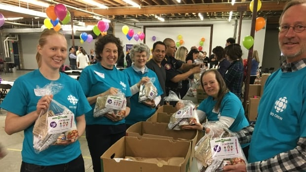 Members of the CBC Do Crew in Calgary assemble food packs at I Can For Kids' warehouse on April 28, 2017.
