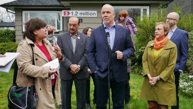 """""""Housing has been neglected by the BC Liberals,"""" said John Horgan as he stood in front of a modest Burnaby home valued at $1.2 million on April 26, 2017."""