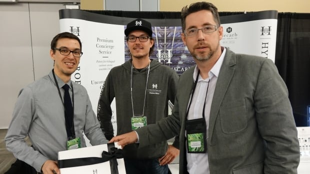 David Robinson, Etienne Joanisse and Shane Morris pose for a photo at the Hydropothecary booth at the Cannabis Canada Forum in Ottawa on April 29, 2017.