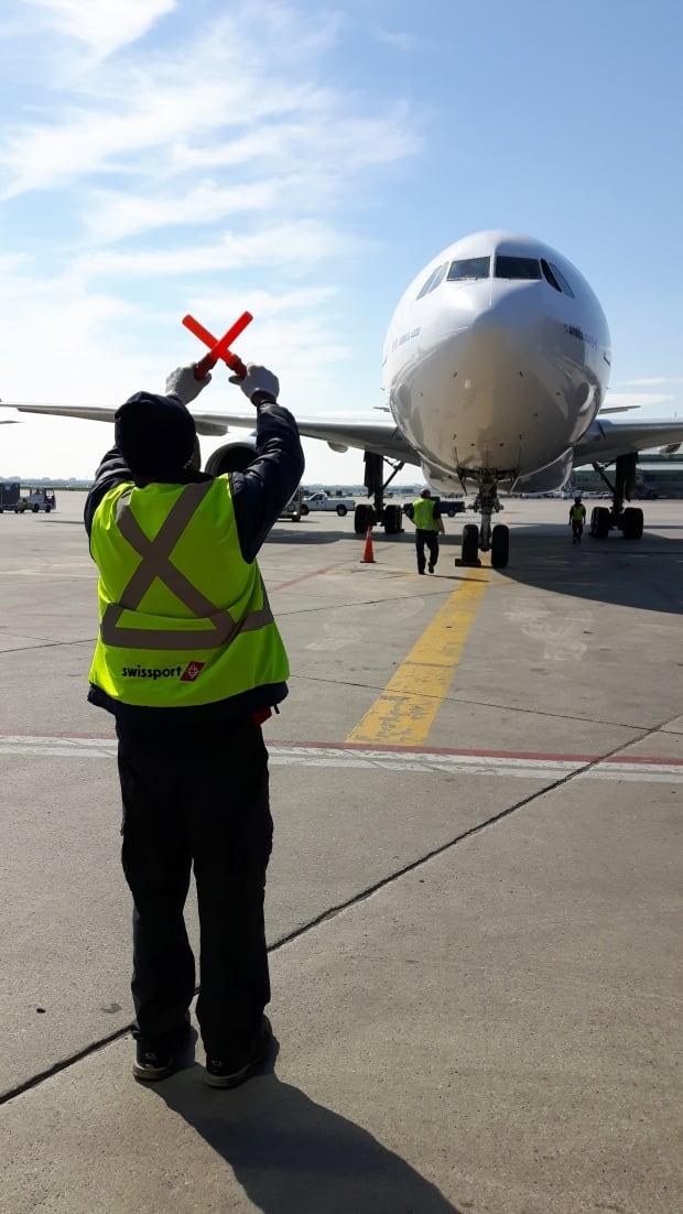 Airport worker baton