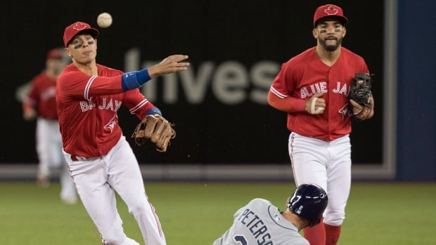 Carpenter's slam in 11th lifts Cardinals over Blue Jays