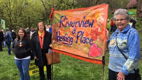 Riverview Hospital Is A Healing Place sign holders rally