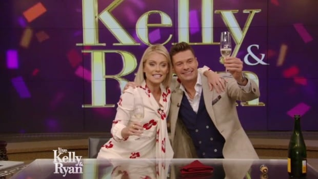 Kelly Ripa and Ryan Seacrest share a toast to becoming new co-hosts of Live on Monday.