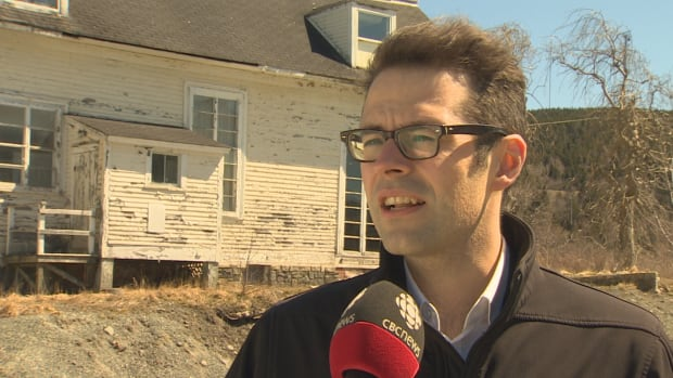 Coun. Dave Lane says it's a daunting task to find the person who has the right expertise and money to restore a heritage property, like Richmond Cottage, pictured in the background.