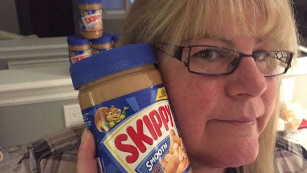 Lori May, of Bowmanville, Ont., with one of her last jars of Canadian-bought Skippy peanut butter.