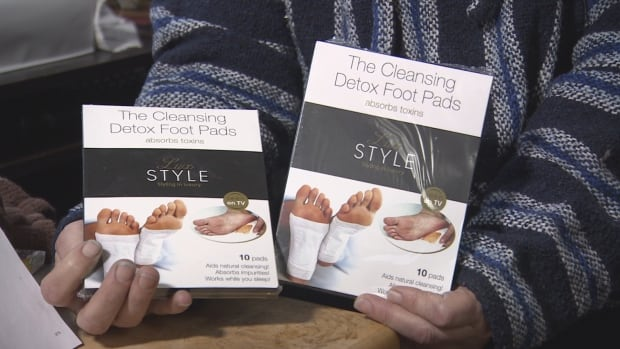Kim Mills holds the LuxStyle detox foot pads that she says she didn't order.