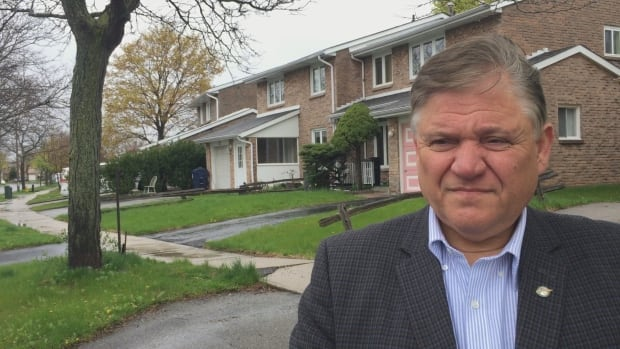 Coun. Jim Karygiannis stands near a heaved sidewalk Tuesday in Scarborough.; In some cases, he believes offending trees should be cut down and replaced.