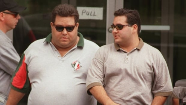 Angelo Musitano (right) and Pat Musitano leaving Provincial Court for lunch in 1998. Angelo was killed in a targeted shooting outside his home on Tuesday.
