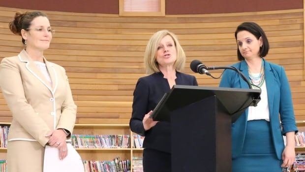 Alberta Premier Rachel Notley was flanked by Melissa Blake, mayor of the Regional Municipality of Wood Buffalo (left), and Children Services Minister Danielle Larivee during a news conference in Fort McMurray to mark the first anniversary of the wildfire.