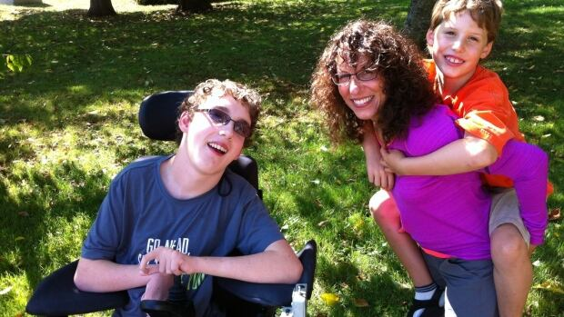 Nathan Shipley, sitting beside his mother and his younger brother, was diagnosed with cerebral palsy quadriplegia shortly after he was born.
