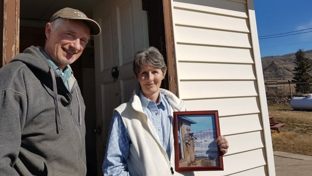 Ken and Arlene Boon stand outside the house her grandfather built in the Peace River valley in the 1940s. After decades of fighting the proposal, the pair will likely have to leave the home to make way for the Site C dam.