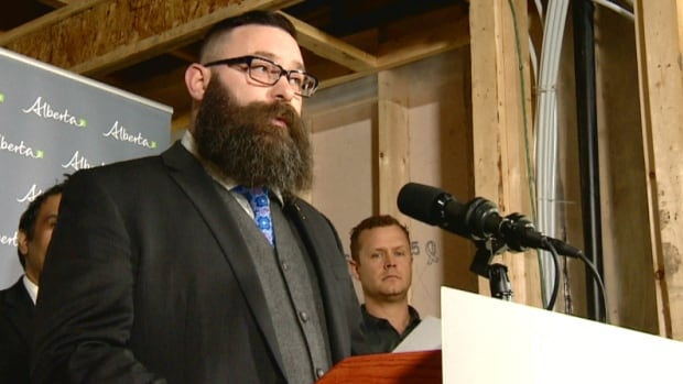 Municipal Affairs Minister Shaye Anderson went to an infill construction site in Edmonton to announce a bill that would license Alberta home builders for the first time.