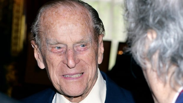 Prince Philip, the Duke of Edinburgh, speaks to guests after attending the Order of Merit service at St. James's Palace in London on Thursday after it was announced he will retire from royal duties this fall.