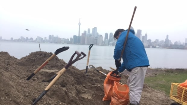 Michael Page spent Thursday filling and laying sandbags in advance of the 70 mm of rainfall in the forecast. He lives on Ward's Island, where residents may face an evacuation order.