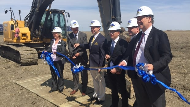 Jeremy Harrison, the minister responsible for the Global Transportation Hub (third from left) and Brightenview CEO Joe Zhou (third from right) were among the group kicking off construction on a $45-million project at the hub Thursday.