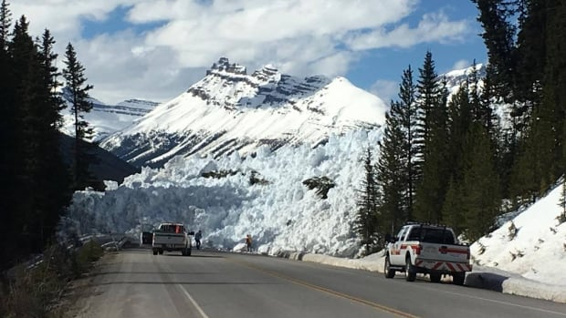 Crews continue to clear away the remnants of a Thursday afternoon avalanche on the Icefields Parkway.
