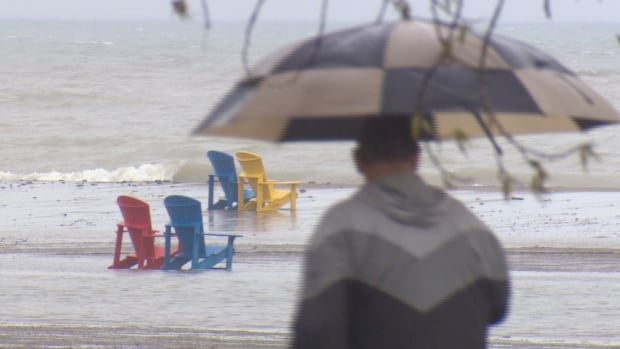 The rain falls and the waves roll in at Woodbine Beach. Parts of the GTA could see up to 70 millimetres of rain before tapering off on Saturday.