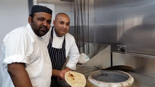 Le Raj cooks Alfen Valles and Mohammed Saleem