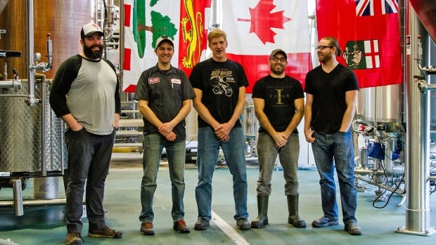 Chris Long (left) poses with some other brewmasters at Central City Brewing in Surrey, where they gathered to brew beer to celebrate Canada's 150th birthday.