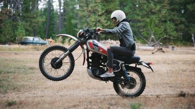 Becky Goebel pops a wheelie on her vintage bike.