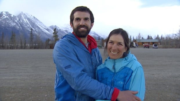 Camilo Rada, left, and Natalia Martinez are reunited at Kluane Lake National Park. Martinez spent four days alone on Mount Logan after a series of earthquakes nearby.