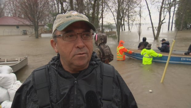 Gilles Leroux said the fast currents brought on by flooding almost took the patio off his cottage, located near Old Highway 17 in Clarence-Rockland, Ont.