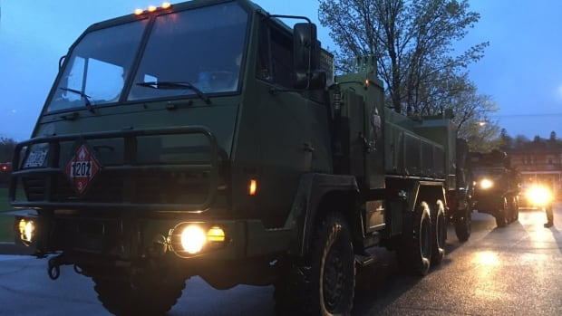 Trucks carrying Canadian soldiers arrive in Gatineau, Que., on May 6, 2017. More than 400 soldiers are being deployed to help with the flooding relief efforts in Quebec.