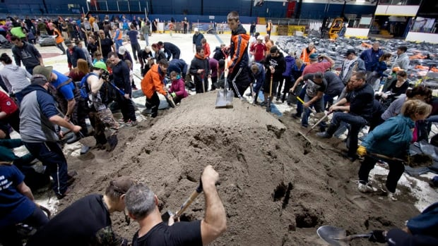 Some 2,000 volunteers showed up at Campeau Arena in Gatineau Saturday, May 6 to help fill sandbags for residents affected by flooding.