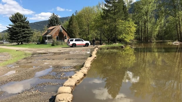 Crews near Grand Forks, B.C., hope sandbags are enough to keep rising flood waters from damaging properties.