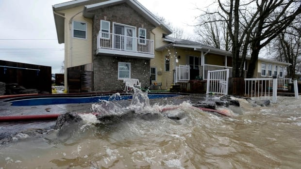 Rising water from the Ottawa River approaches a home in Clarence-Rockland, Ont., during this spring's flooding. Ontario's Ministry of Natural Resources and Forestry is warning people living along the river east of Ottawa to stay away from fast-moving water after this past weekend's heavy rains.