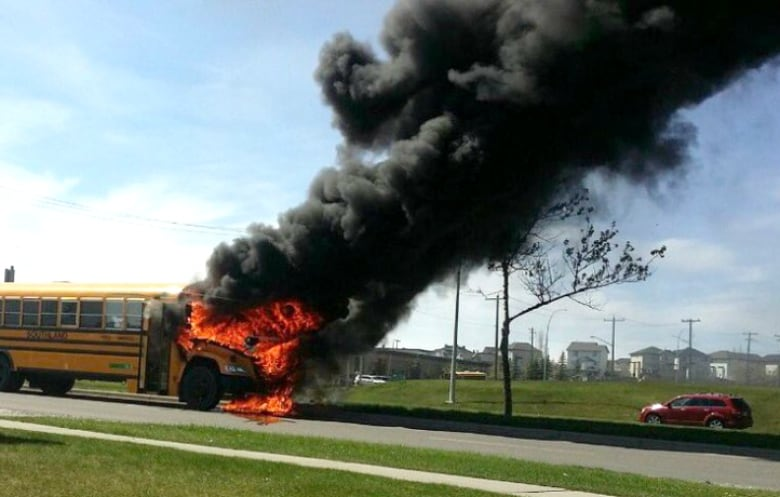 Screaming children flee Calgary school bus moments before it bursts into flames