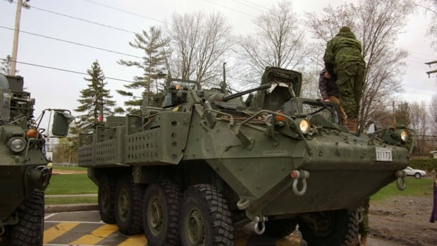 The Canadian Armed Forces assist with flooding in the town of Oka. The neighbouring Kanesatake band council turned down the army's help.