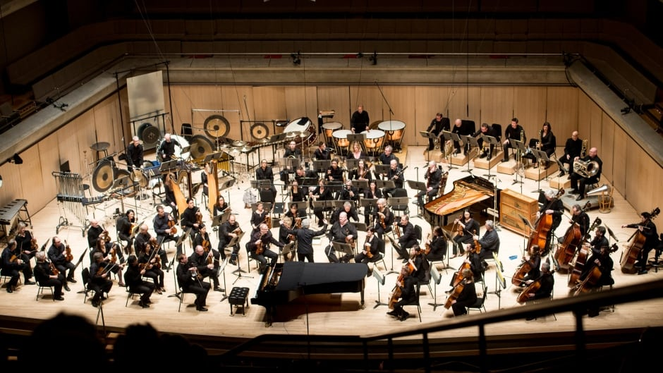 A Toronto Symphony Orchestra performance, which includes the use of a new instrument made out of a giant steel sheet.