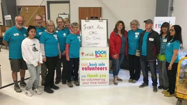 Angela Knight and members of the CBC Do Crew volunteer at the CBC Calgary Reads Big Book Sale on May 4, 2017.