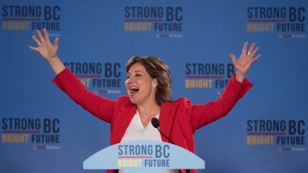 B.C. Liberal Leader Christy Clark waves to the crowd in Vancouver Wednesday following the B.C. election. The Liberals held on to government with a minority win.