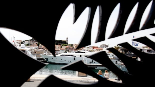 After a backlash over programming Netflix films, the Cannes Film Festival said Wednesday it will, beginning next year, only accept theatrically released films for its prestigious Palme d'Or competition.