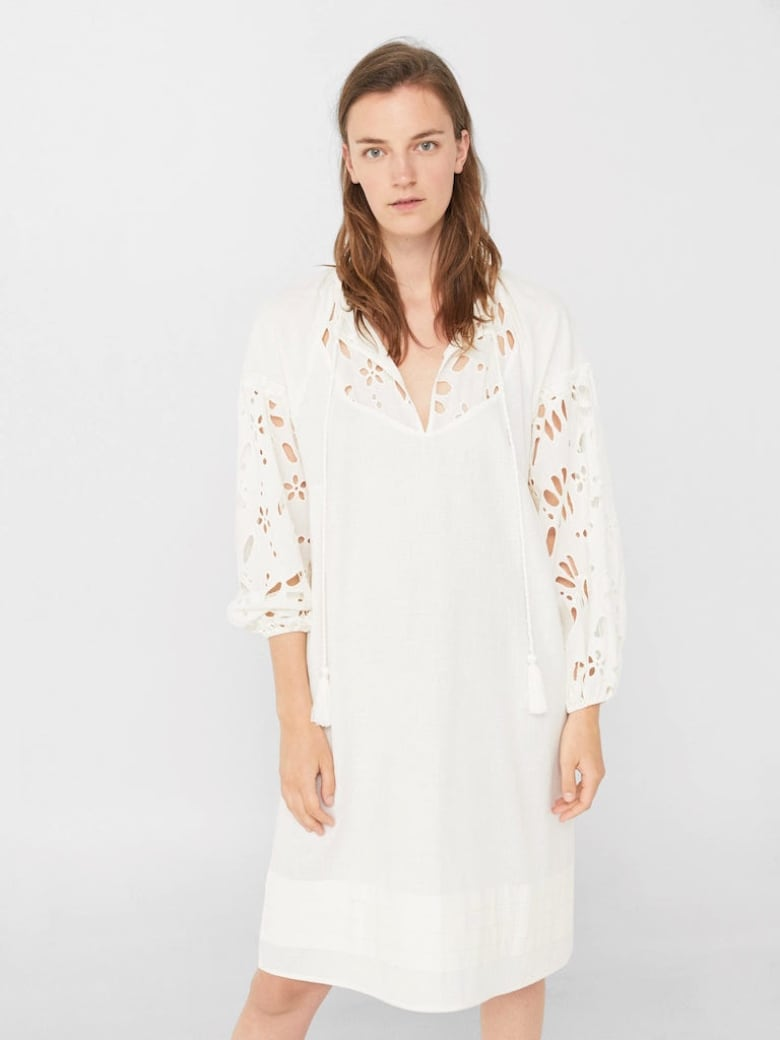 687eda193642 A little white dress is a summer staple but yours doesn t have to be so  little. Long-sleeves with open floral details and a knee-length hem ensure  you won t ...