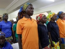 The 82 freed Chibok schoolgirls arrived in Nigeria's capital, May 7, 2017, as anxious families awaited for an official list of names hoping to be reunited.