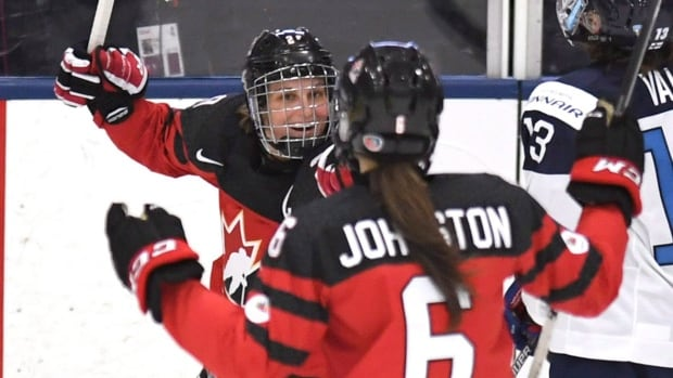 Marie-Philip Poulin, left, is among 28 players invited to try out for the Canadian Olympic women's hockey team. The Beauceville, Que., native scored both the tying goal and overtime winner for Canada in a 3-2 win over the U.S. in the 2014 Olympic final in Sochi, Russia.