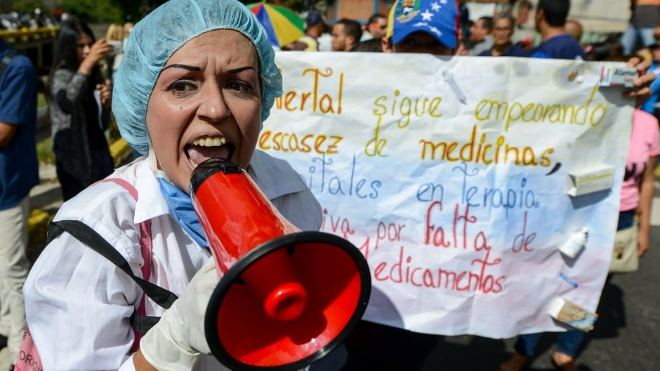 Health-care workers protest against Venezuela's president Nicolas Maduro's government about the lack of medicines and low salaries in the country, Feb. 7, 2017.